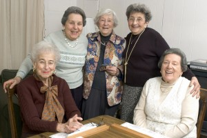 Senior Woman At The Game Table